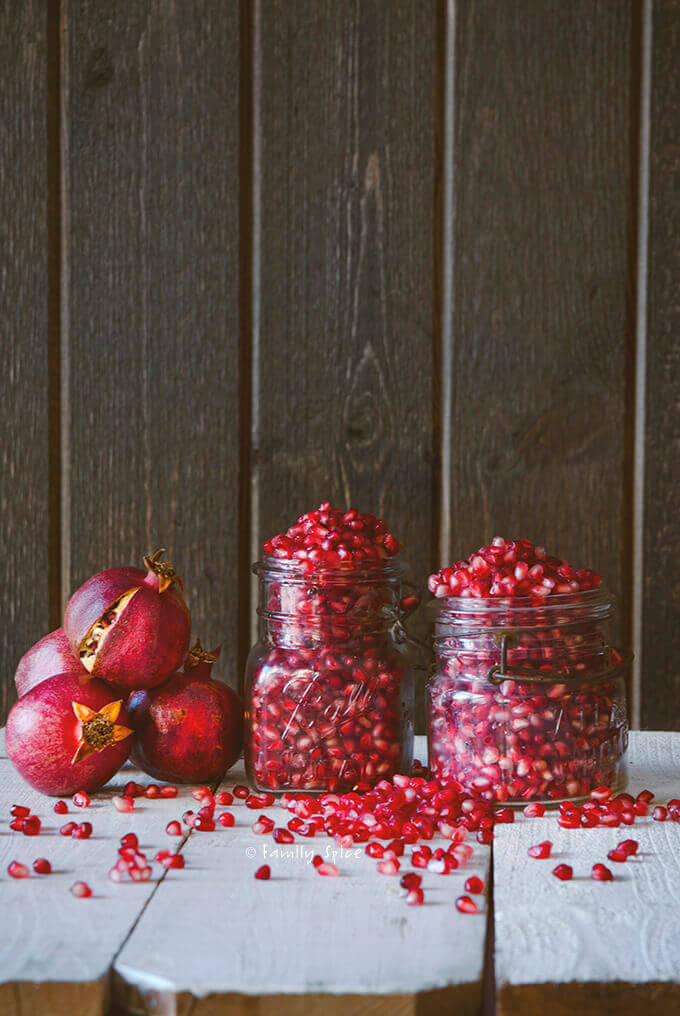 Mason jars full of pomegranate arils by FamilySpice.com