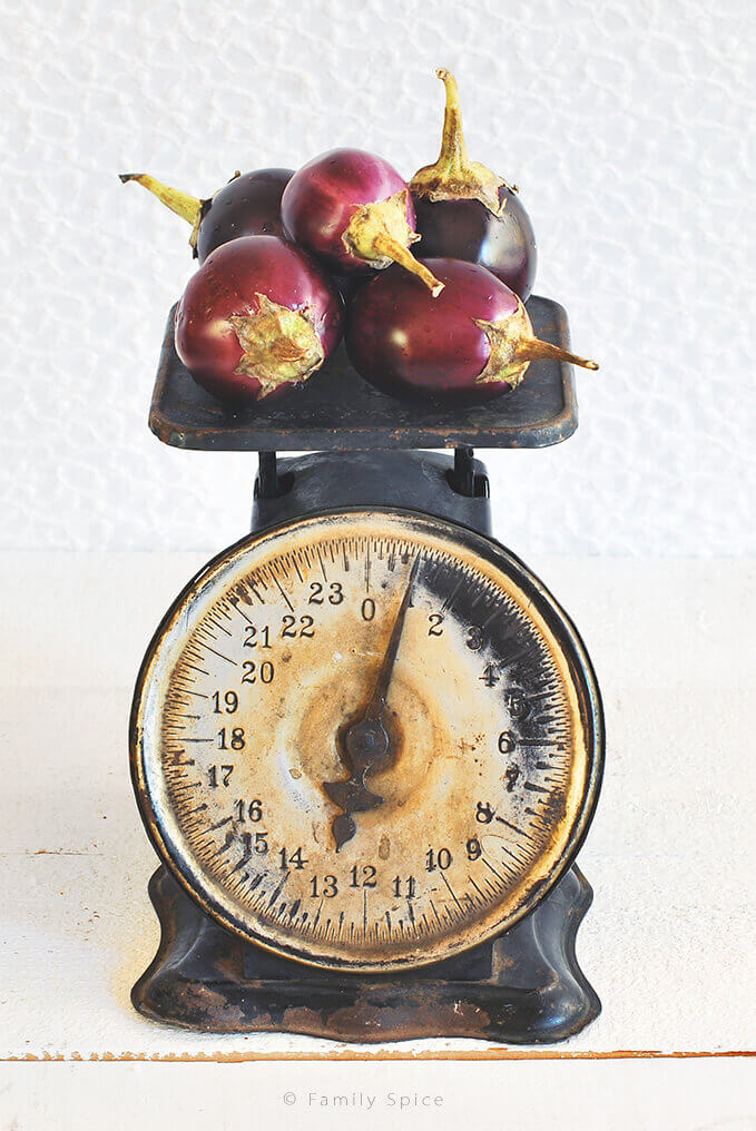 Baby eggplants on antique scale by FamilySpice.com