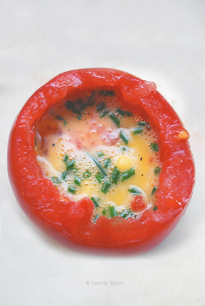 About to Cook Baked Eggs in Tomatoes by FamilySpice.com
