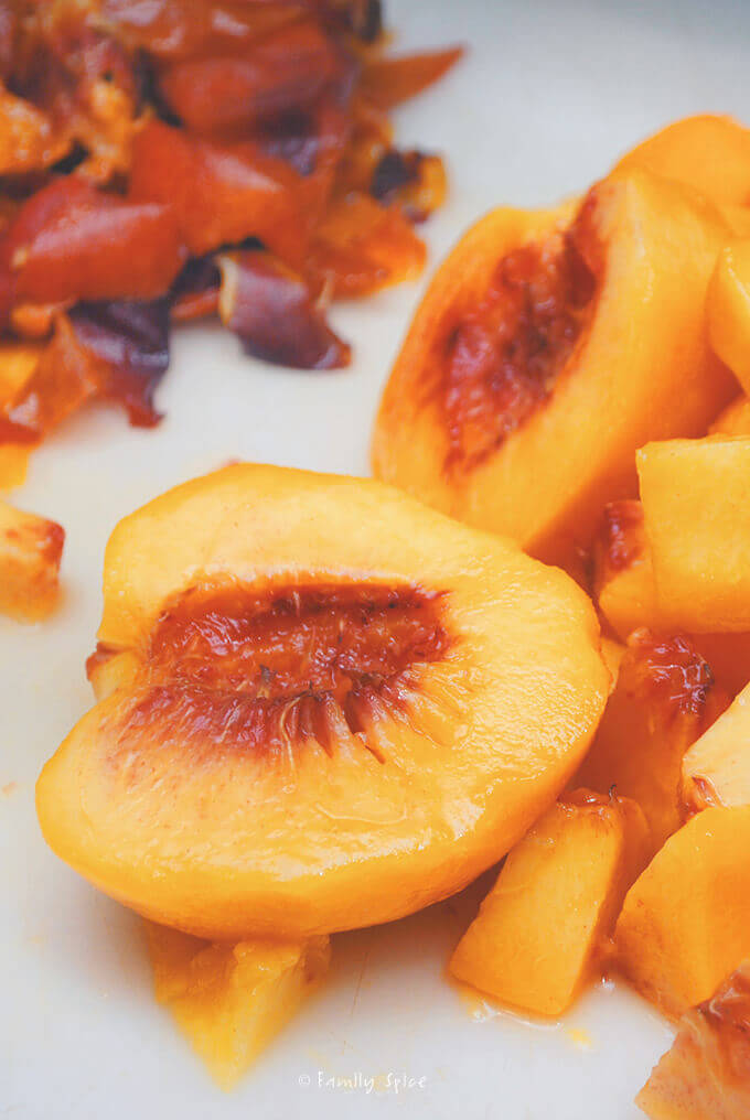 Chopping up peaches for Peach Crisp with Almonds by FamilySpice.com