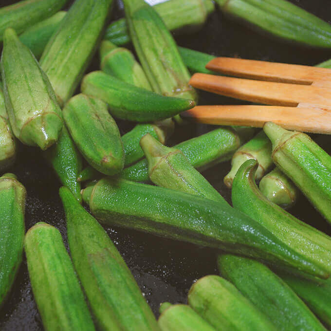 Frying okra for Persian Okra Stew (Khoreshteh Bamieh) by FamilySpice.com