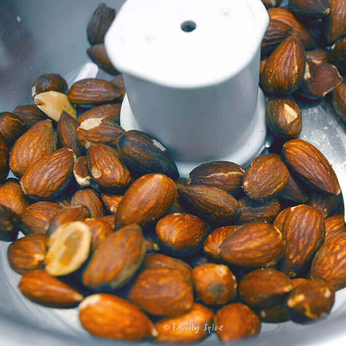 Grinding toasted almonds by FamilySpice.com