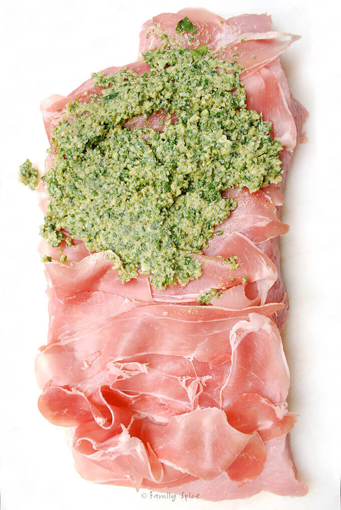 Assembling Stuffed Pork Loin with Prosciutto and Basil Pesto by FamilySpice.com