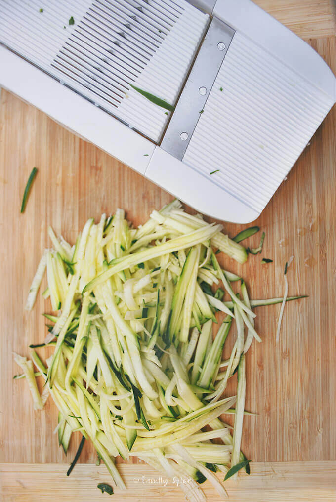Zucchini cut with a mandoline by FamilySpice.com