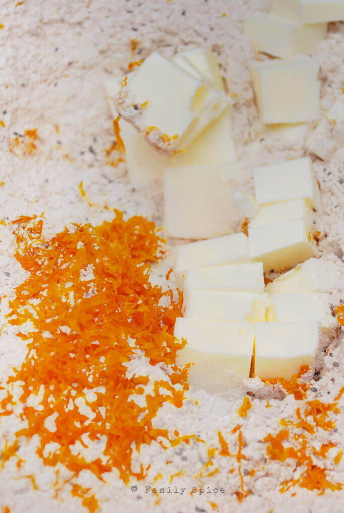 Adding butter and zest while making Whole Wheat Orange Scones with Chia Seeds by FamilySpice.com