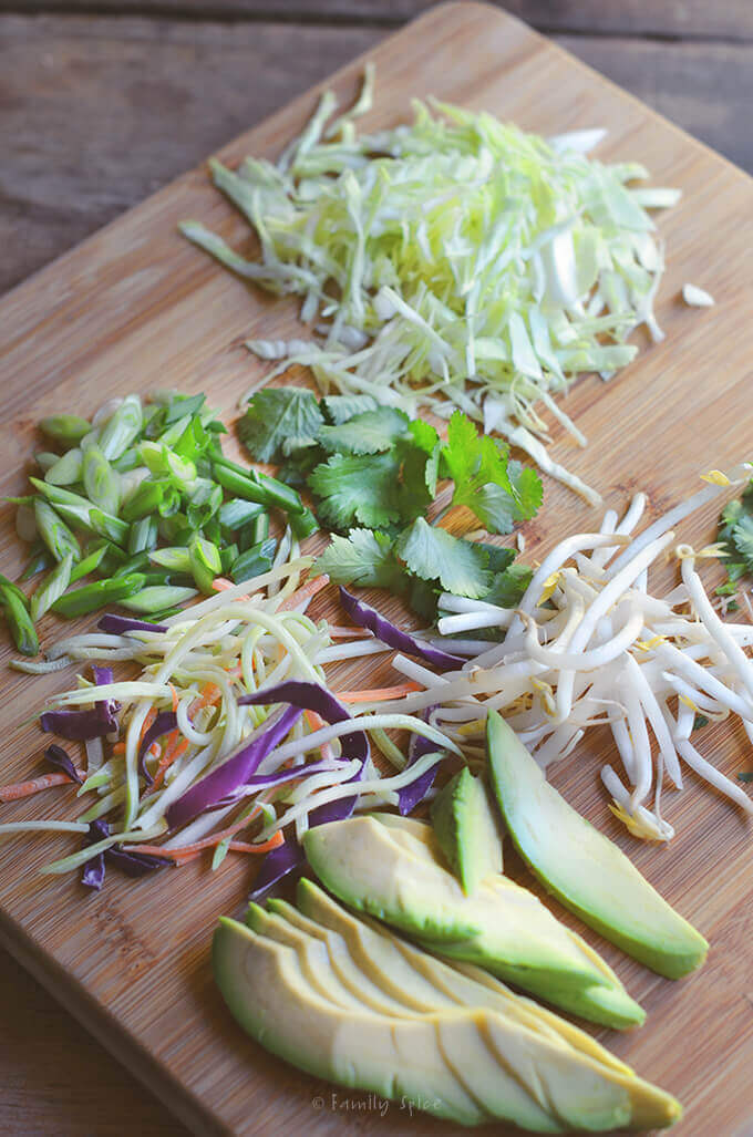 Toppings for East meets west with this ridiculously easy, lip-smacking good Asian Fusion Slow-Cooker Pulled Pork Tacos by FamilySpice.com