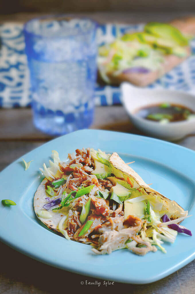 East meets west with this ridiculously easy, lip-smacking good Asian Fusion Slow-Cooker Pulled Pork Tacos by FamilySpice.com