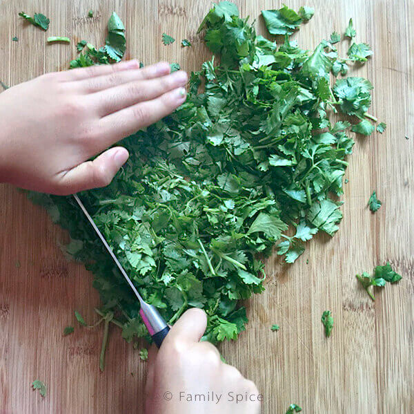 Kids Do Eat Real Food | Kids chopping cilantro by FamilySpice.com