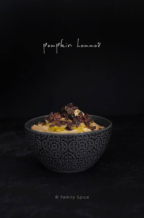 Pumpkin hummus is a festive appetizer and a creative way of to bring the taste of fall and feature pumpkin flavor to your plate. It makes a spooky Halloween appetizer or a bright treat on your Thanksgiving table - by FamilySpice.com
