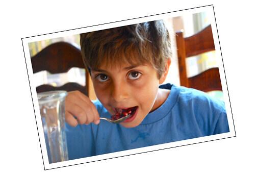 My beautiful boy eating pomegranite --- FamilySpice.com