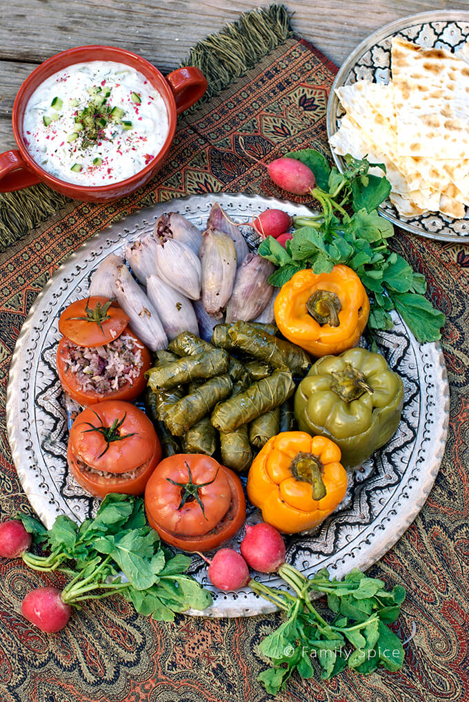 Persian dolmeh platter with stuffed grape leaves, onions, tomatoes and bell peppers - by FamilySpice.com