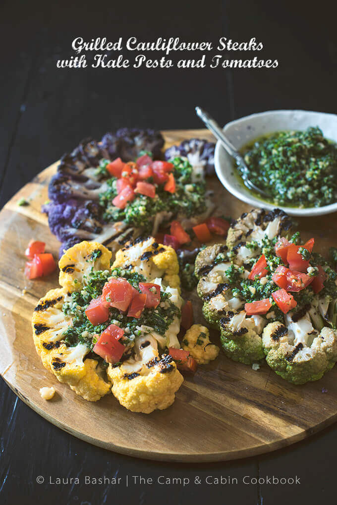 Grilled Cauliflower Steaks with Kale Pesto and Tomatoes from The Camp & Cabin Cookbook: 100 Recipes to Prepare Wherever You Go by Laura Bashar of FamilySpice.com