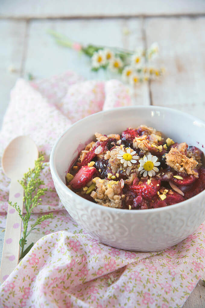 Berry Crisp with Pistachios from the Camp & Cabin Cookbook by Laura Bashar | FamilySpice.com