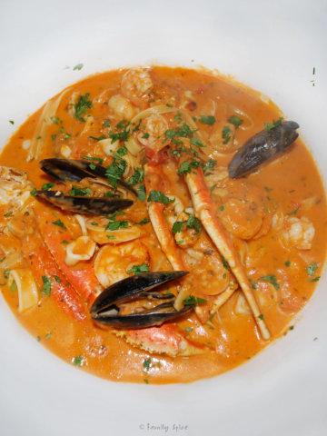 Top view of a big white bowl with Brazillian seafood stew in it