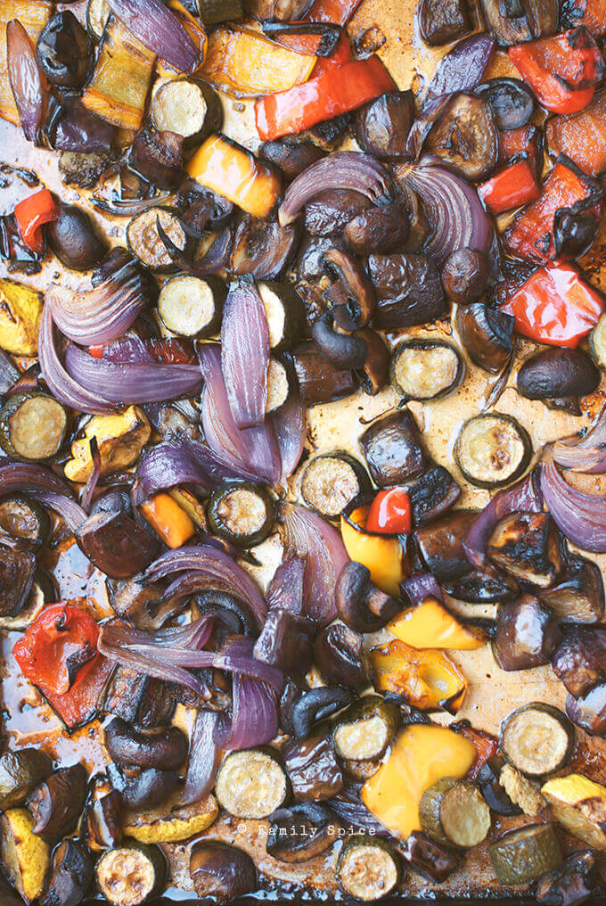 Sheet pan filled with roasted balsamic vegetables by FamilySpice.com