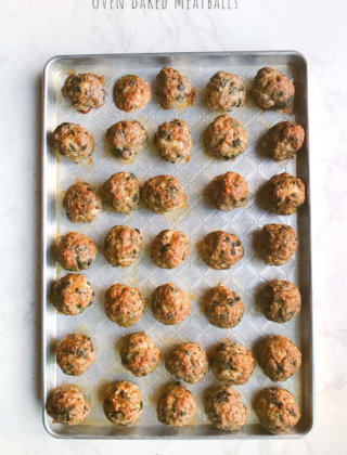 A baking sheet filled with oven bake meatballs by FamilySpice.com