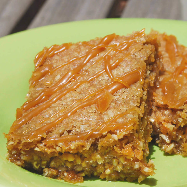 Two oatmeal butterscotch bars on a green plate