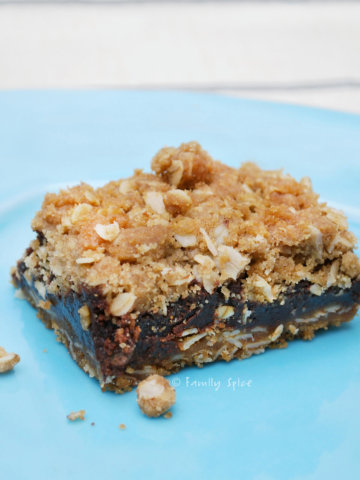 Closeup of a slice of oatmeal fudge bar on a blue plate