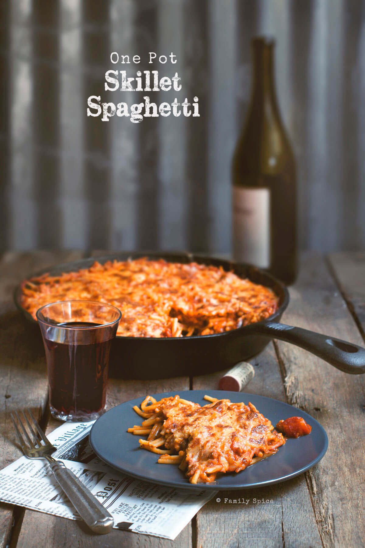 Cast iron skillet with baked spaghetti by FamilySpice.com