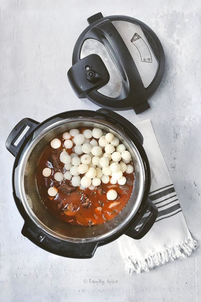 Adding frozen pearl onions to the beef bourguignon in the instant pot