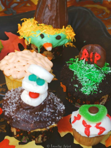 An assortment of halloween cupcakes made with everyday candies