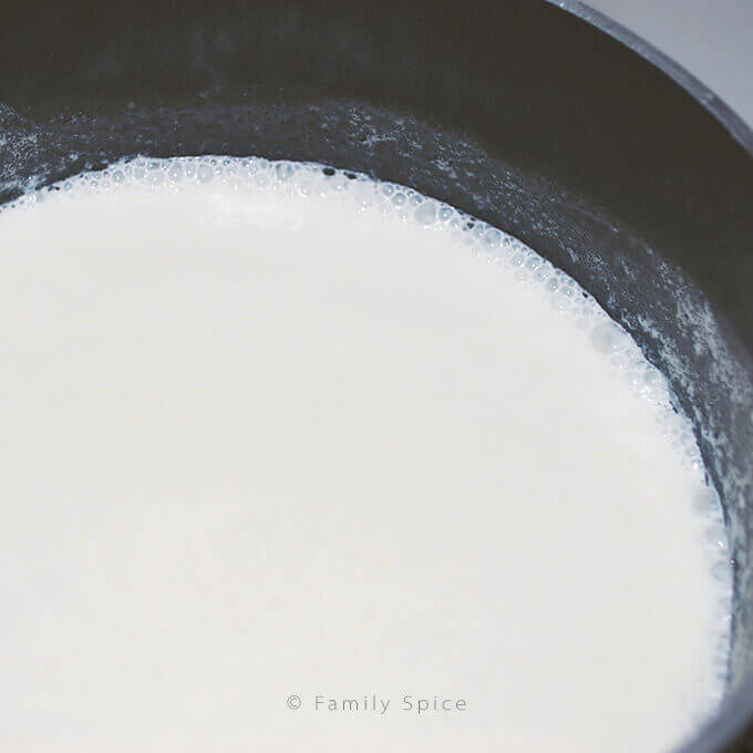 Carefully scalding milk to make the Barefoot Contessa creme bruee by FamilySpice.com