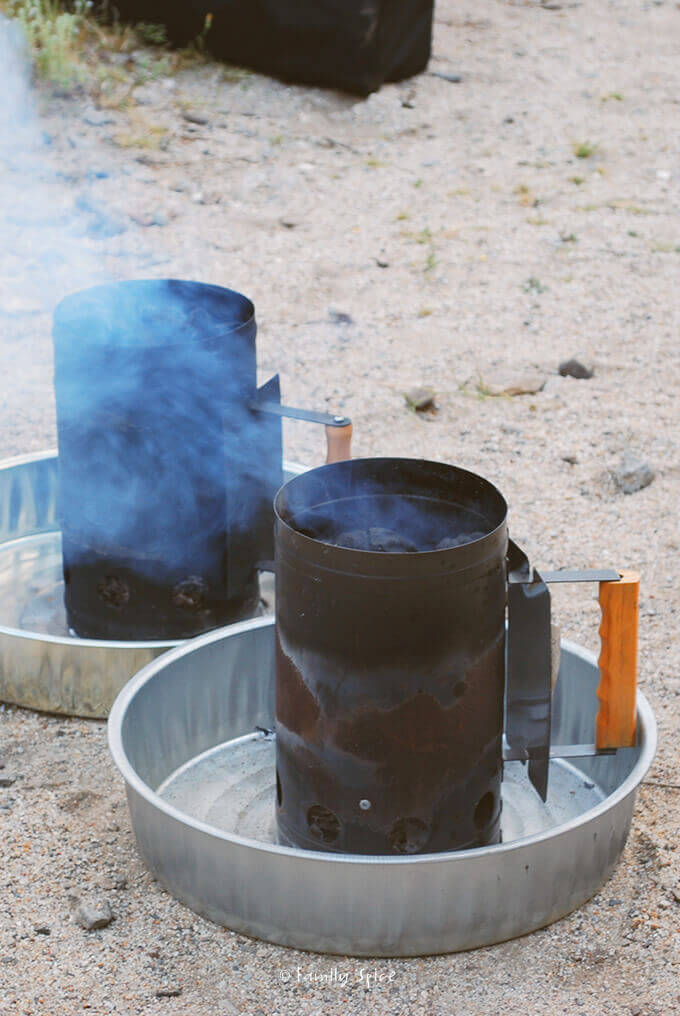 Hot coals smoking in chimneys for Dutch oven cooking by FamilySpice.com