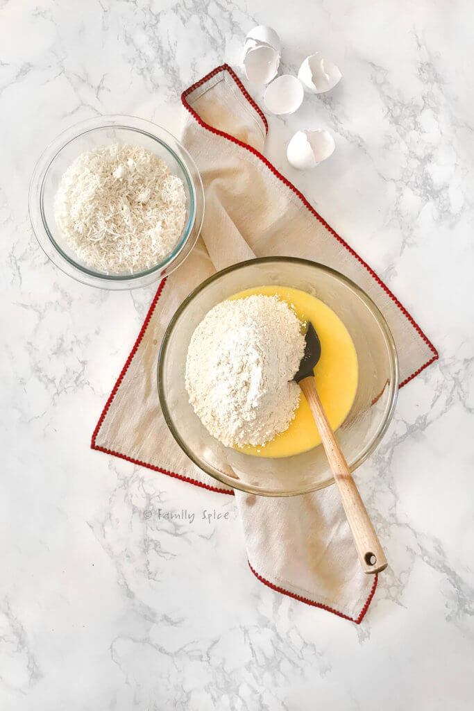 Adding flour mixture to coconut cupcake batter