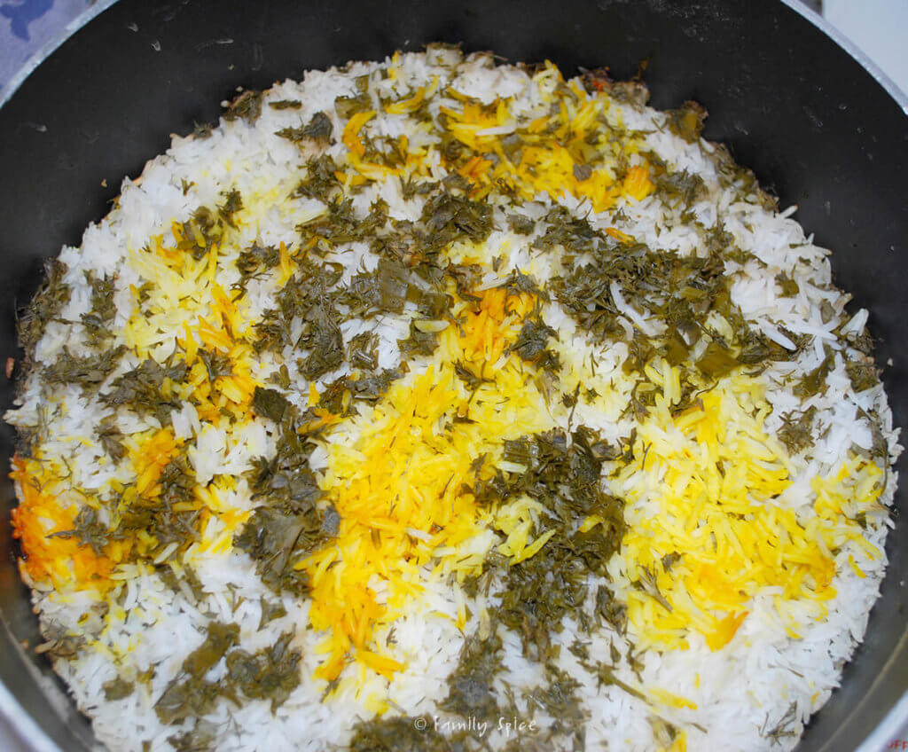 A pot with freshly steamed sabzi pollo (persian herb rice) in it