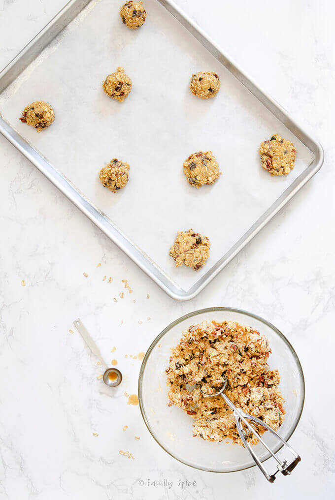 Batter in a mixing bowl plus Ina Garten Oatmeal Raisin Cookies ready to bake by FamilySpice.com
