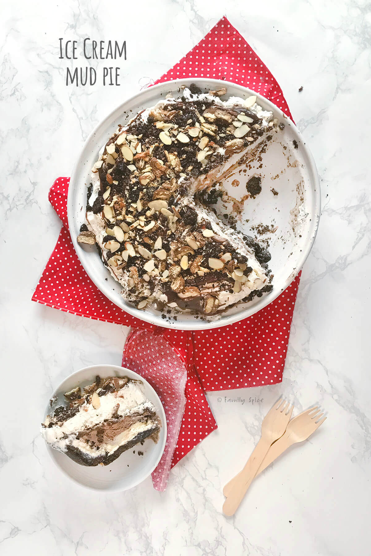 Overhead view of final ice cream mud pie with a slice cut out and on a small white plate by FamilySpice.com