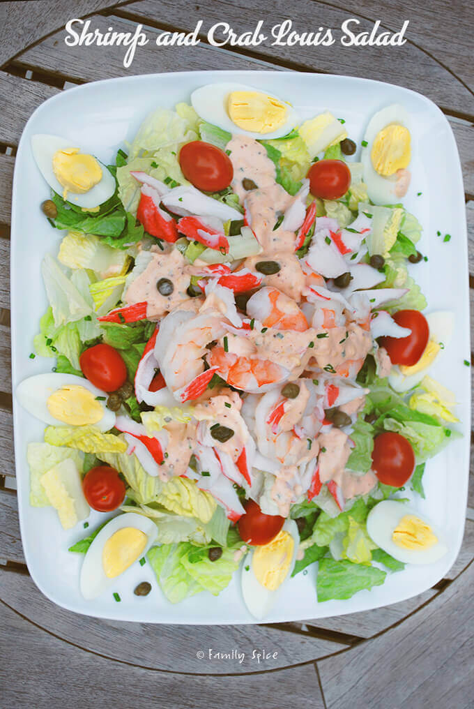 Overhead view of a plate filled with shrimp and crab Louie salad by FamilySpice.com