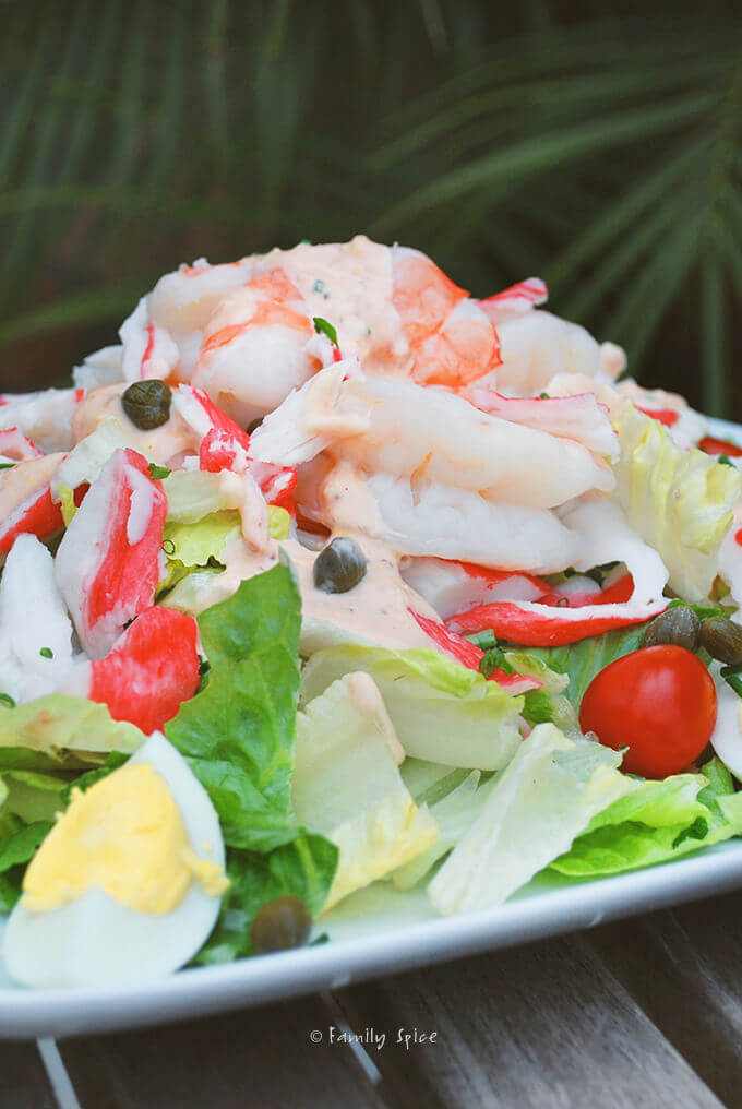Closeup view of a plate filled with shrimp and crab Louie salad by FamilySpice.com