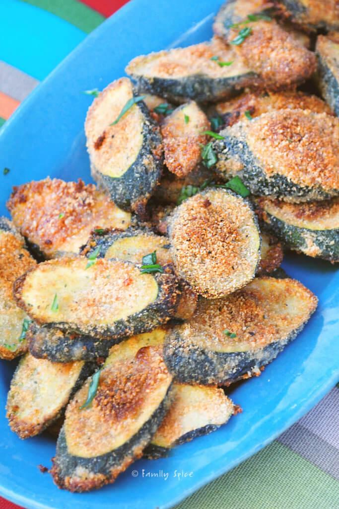 Parmesan zucchini crisps on a blue plate