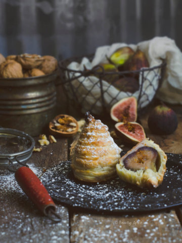 Figs baked in puff pastry and dusted with powdered sugar