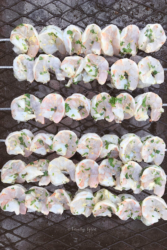 Overhead shot of Ina Garten Grilled Herb Shrimp Kabob on the grill by FamilySpice.com