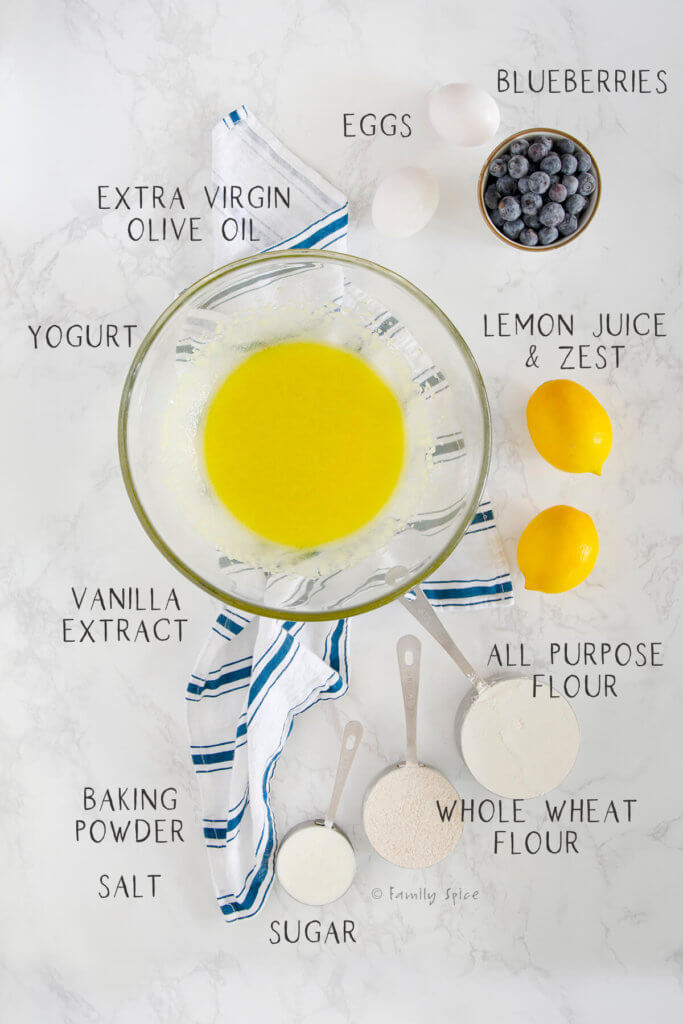 Ingredients with text to make lemon blueberry muffins