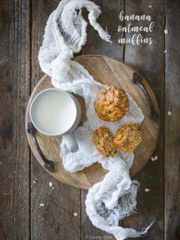 Overhead view of a small wooden tray with a mug of milk and a couple banana oatmeal muffins by FamilySpice.com