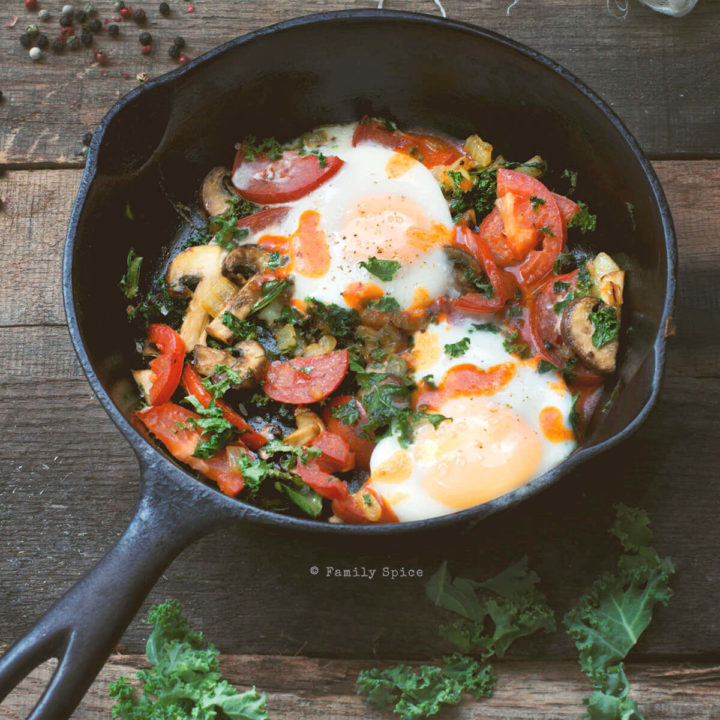 Baked Eggs with Kale, Tomatoes and Mushrooms