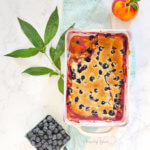 The juicy filling of a peach blueberry cobbler by FamilySpice.com