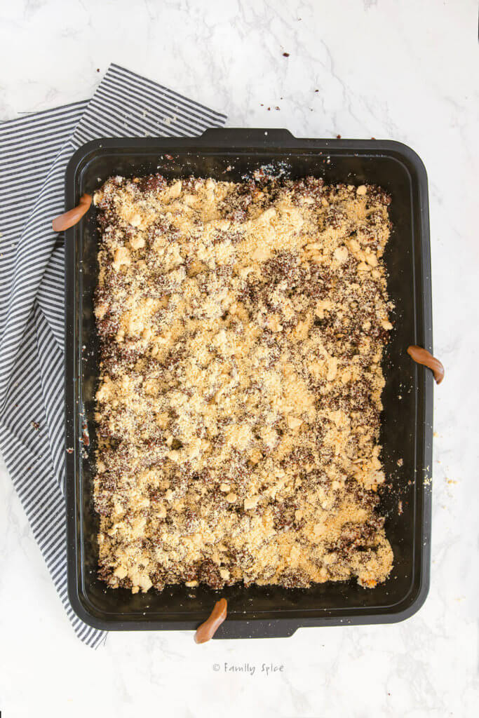 Assembling the layers in a kitty litter cake
