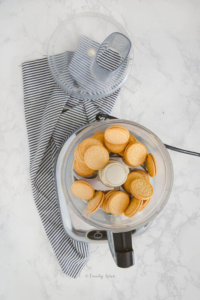 Vanilla sandwich cookies in a food processor