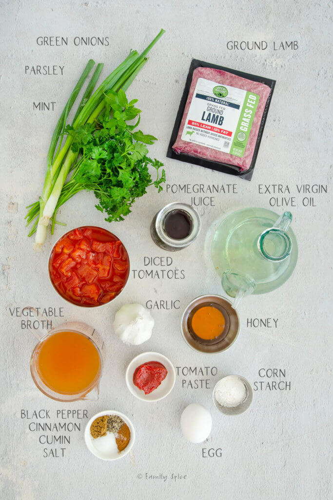 Ingredients labeled and needed to make lamb meatballs with with tomato pomegranate sauce