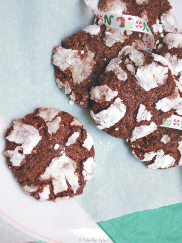 Almond chocolate crinkle cookies on a white dish