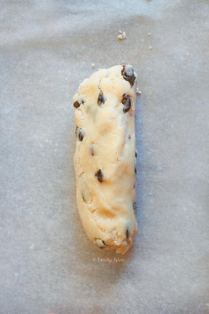 Cherry orange cookie dough rolled into a log and refrigerated