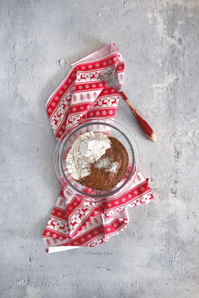 Flour, cocoa powder and salt in a small glass bowl with a whisk