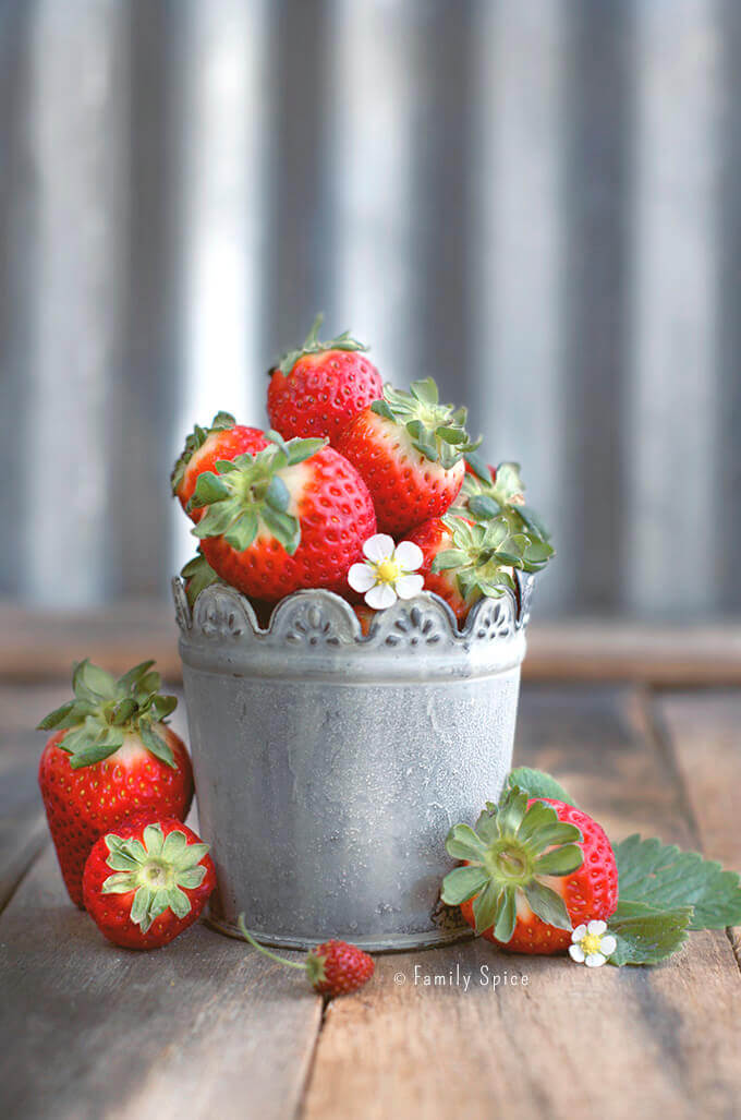 Fresh strawberries in a rustic metal pot by FamilySpice.com