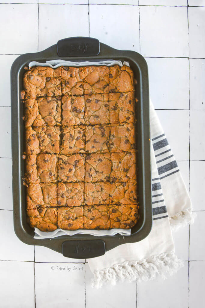 Freshly baked brookies in a baking pan cut into squares