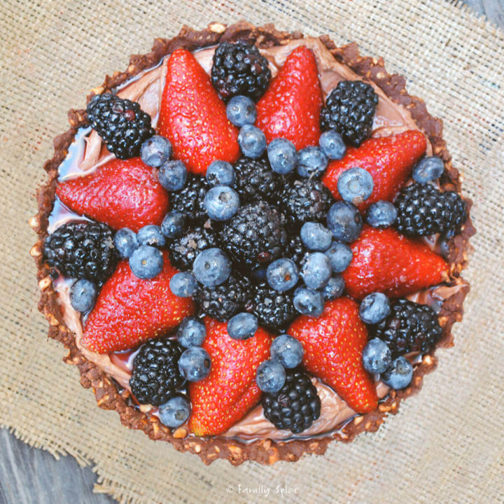Top view of a Nutella pie with a variety of berries on top