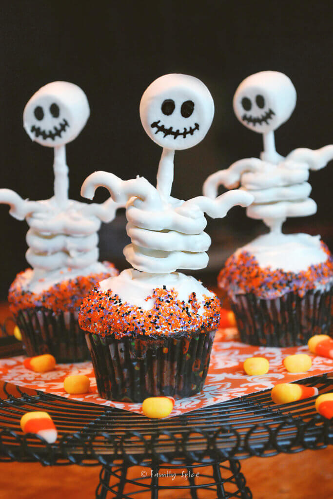 Edible skeletons on cupcakes made with marshmallow and yogurt covered pretzels